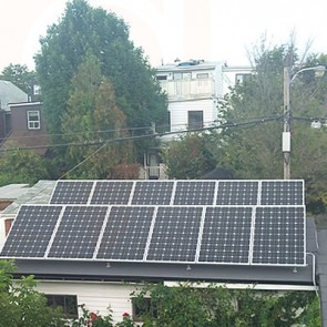 Solar power panels on garage rooftop